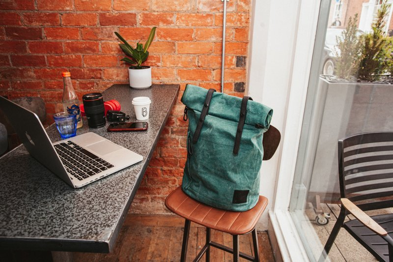 Cora + Spink backpacks in local coffee or bottle shop Bayleys